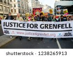 London, United Kingdom, November 17th 2018:- Justice for Grenfelll marchers at the Stand Up To Racism march through central London from the BBC to near Downing Street in Whitehall - stock photo