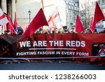 London, United Kingdom, November 17th 2018:- Reds at the Stand Up To Racism march through central London from the BBC to near Downing Street in Whitehall - stock photo