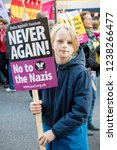 London, United Kingdom, November 17th 2018:- A young marcher at the Stand Up To Racism march through central London from the BBC to near Downing Street in Whitehall - stock photo
