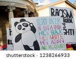 London, United Kingdom, November 17th 2018:- A placard at the Stand Up To Racism march through central London from the BBC to near Downing Street in Whitehall - stock photo