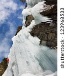 Ice climbing a wall of ice in South Tyrol, Italy. - stock photo