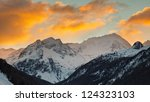 Hochgall Mountain, the highest peak of the Riesenfernergruppe mountain range, in South Tyrol, Italy, at sunrise on a winter day. - stock photo