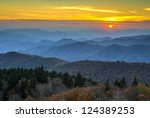 Blue Ridge Parkway Autumn Sunset over Appalachian Mountains Layers covered in fall foliage and blue haze - stock photo