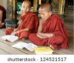NYAUNG SHWE, MYANMAR NOVEMBER 22: Unidentified novice at Shwe Yan Phe Monastery on Nov. 22 , 2011 in Nyaung Shwe, Myanmar. Young boys have to enter the Buddhist Order as a novice. - stock photo