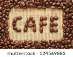 coffee beans frame with cafe text on sacking background - stock photo