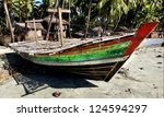 old boat in asia is used to dry fish in the sun - stock photo