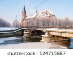 View to pedestrian bridge (Honigbrucke) and Kant's cathedral in Kaliningrad. Russia - stock photo