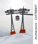 Gondola between two ski lift pylons at Kronplatz Ski Resort, South Tyrol, Italy - stock photo