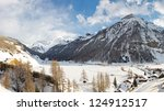 Rein in Taufers, an idyllic village in the Alps, South Tyrol, Italy, on a beautiful winter day. - stock photo