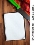 the blank recipe book and kitchen knife - stock photo