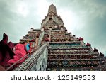 BANGKOK, THAILAND - AUGUST 3: Buddhist monks walk up stairs of Wat Arun temple, in Bangkok on August 3, 2012. Buddhism is Thailand official religion and is the religion of more than 90% of its people - stock photo