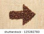 coffee beans arrow on sacking background - stock photo