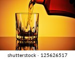 Pouring whisky into a glass - stock photo