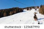 Gondola ski lift going up to the summit of Kronplatz Ski Resort, South Tyrol, Italy. - stock photo