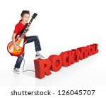 Boy plays  on electric guitar. The boy stands on the word of the rock'n'roll from the 3d text - isolated on white background - stock photo