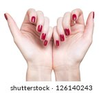 hands with woman's professional red nails manicure isolated on white - stock photo