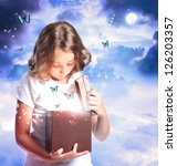 Happy Girl Opening a Box with Blue Butterflies - stock photo