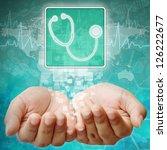 Stethoscope symbol on hand ,medical background - stock photo