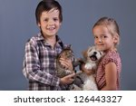 Beautiful kids with their lovely pets - portrait - stock photo