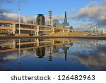 Modern cityscape with natural reflections in a puddle of Kobe, Japan. - stock photo