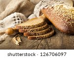 Bread rye  on old wooden table - stock photo