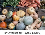 Pumpkins and Vegetables on Market Stall - stock photo