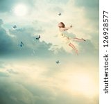 Little Blonde Girl Flying with Butterflies at Twilight - stock photo