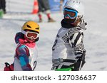 Girls on the ski competition - stock photo