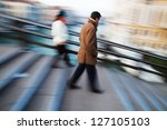 people in motion blur on the move on a bridge in Venice - stock photo
