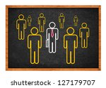 Businessman with his bodyguards, drawing on black chalkboard - stock photo