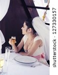 Beautiful bride on the yacht with a glass of champagne. - stock photo