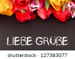 Bunch of tulips with blackboard: kind  regards - stock photo