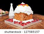 Christmas cake with red candieds and white candle - stock photo