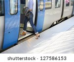 Woman enters train (anynomized in several ways) - stock photo