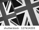 Two Union Jack Flags of UK as a Background in Black and White Sepia Tone - stock photo