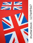 Two Union Jack Flags on Red Background - stock photo
