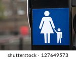 Woman and Child on Sign on Traffic Light - stock photo