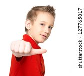 Portrait of boy showing thumbs up sign isolated on white background - stock photo