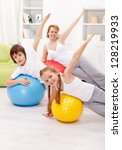 Healthy life concept with exercising people on large gymnastic balls - stock photo