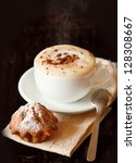 Cup of coffee cappuccino with chocolate and fruitcake. - stock photo