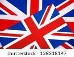 Two Union Jack Flags One Placed on to of the Other - stock photo