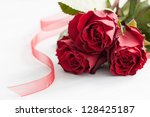 red roses on white wood - stock photo