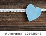 blue heart shape on brown wood - stock photo
