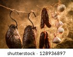 Closeup of Ham, sausage and garlic in a smokehouse - stock photo