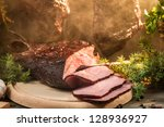 Closeup of freshly smoked ham in country smokehouse - stock photo