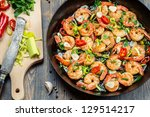 Freshly fried shrimps served on pan - stock photo