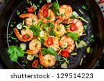 Closeup of shrimps fried on pan - stock photo