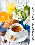 Cup of coffee and fresh croissant for breakfast. - stock photo