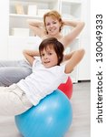 Healthy life - people exercising at home - stock photo