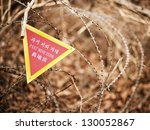 A sign indicating the end of a landmine zone in South Korea, a poignant reminder of the unresolved conflict in the region. - stock photo